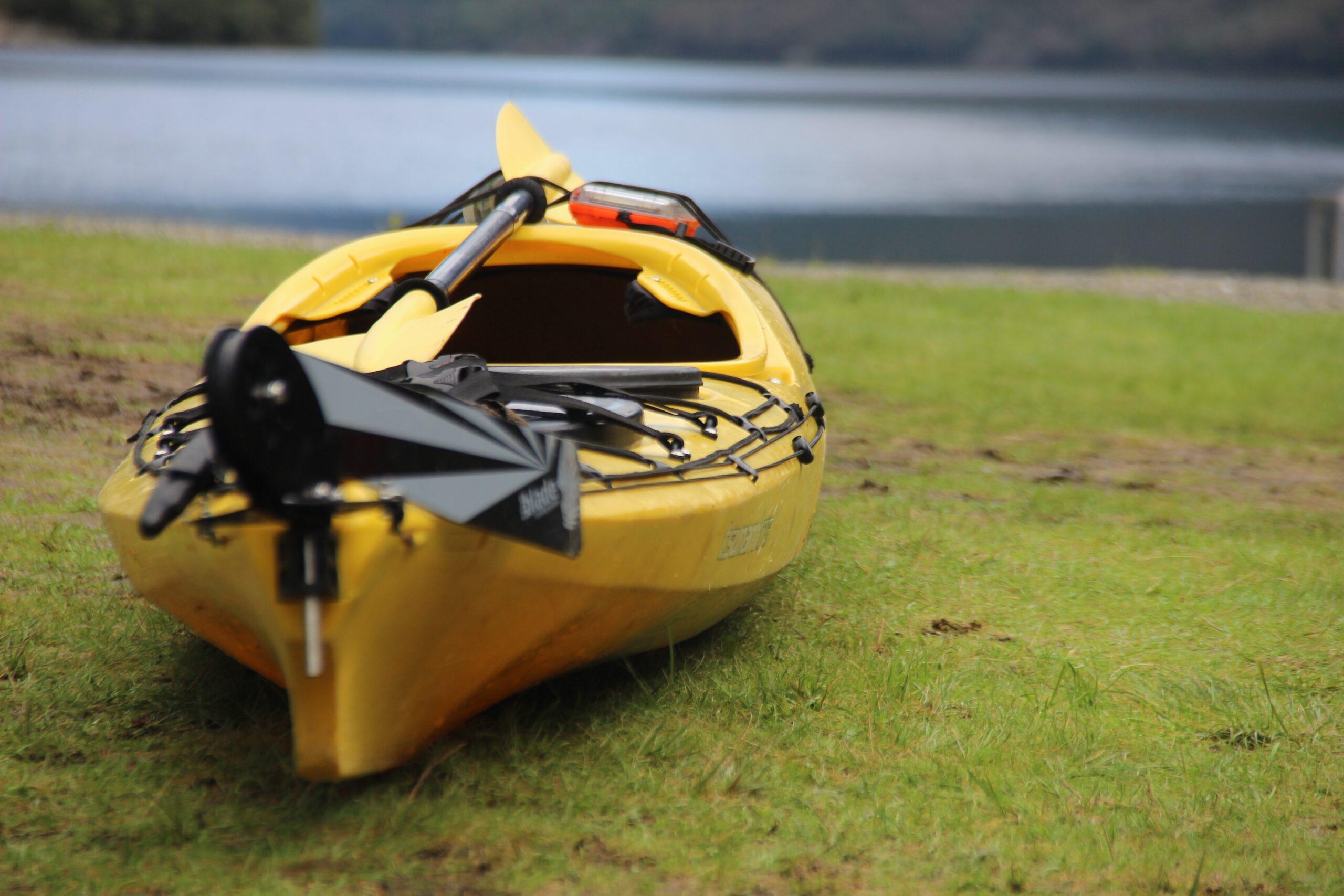 selective focus photography of yellow kayak