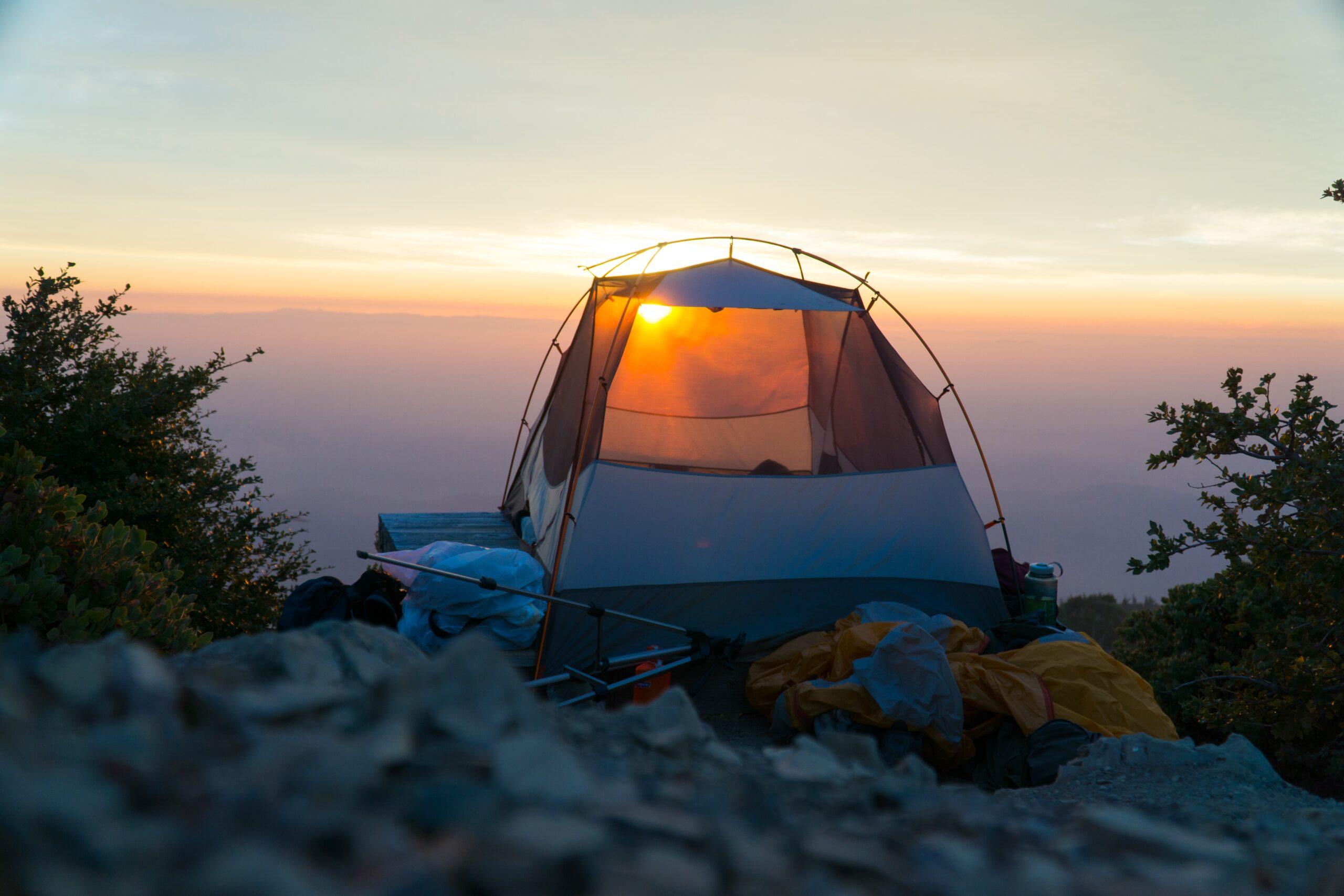 sun raise behind dome tent