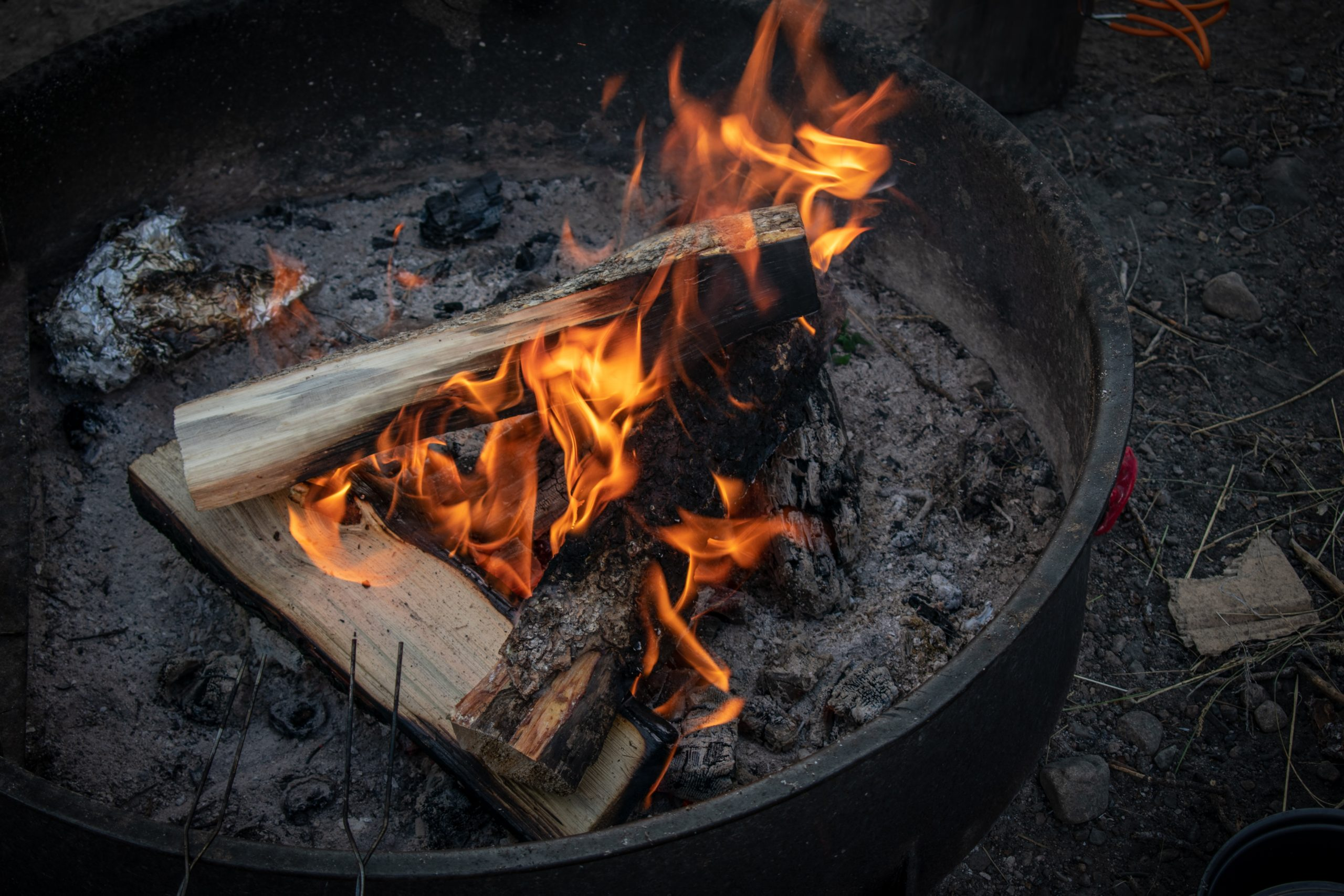 lit firewoods in firepit
