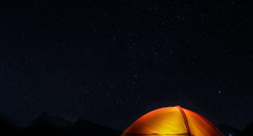 orange tent under the night sky